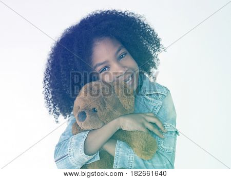 Young girl Cudding teddy bear