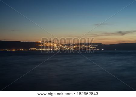 Night view of Tiberias (Tveria) from the opposite shore of Kinneret Lake (Sea of Galilee)