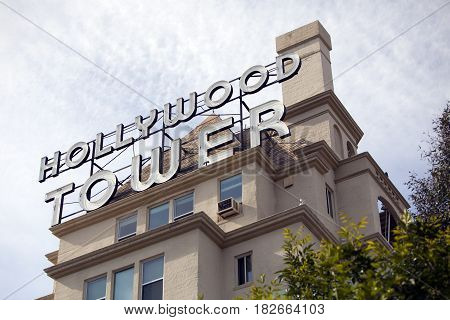 Los Angeles USA - April 17 2017: The facade for the famous Hollywood Tower originally known as La Belle Tour. It is a large apartment building in Hollywood Los Angeles California.