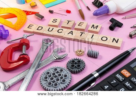 School Equipment With Word Stem Education Over Pink Background In Education Stem Concept. School Des