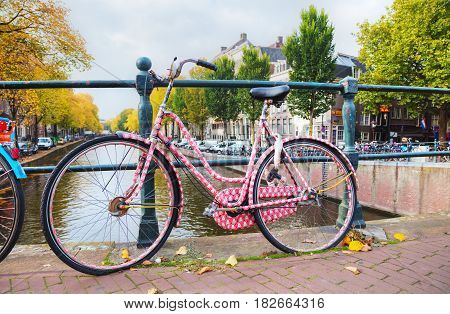 AMSTERDAM - OCTOBER 27: Bycicle parked at the bridge on October 27 2016 in Amsterdam Netherlands.