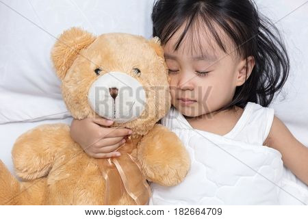 Asian Little Chinese Girl Sleeping With Teddy Bear