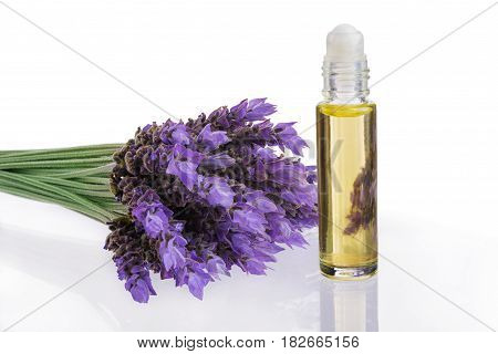 essential oil and fresh lavender flowers as natural aromatherapy isolated on white background