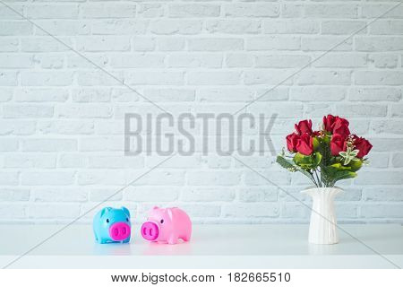 The two piggy bank On a white table For savings