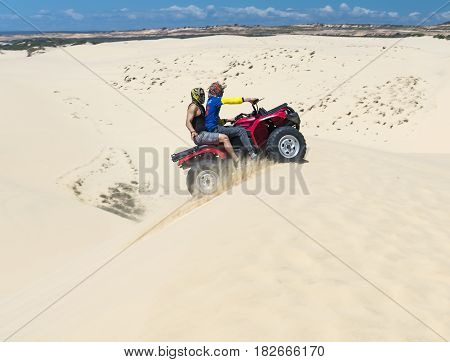 Mui Ne, Vietnam - February 18th, 2017: Travelers are experiencing the thrill of crossing the sand dunes by the off-road vehicle at Mui Ne, Vietnam.