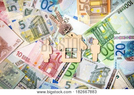 Symbol of home and family against the background of the Euro currency