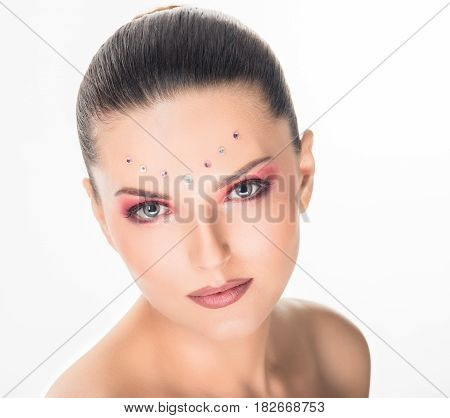 Portrait of fashion beautiful young woman with crystals make-up