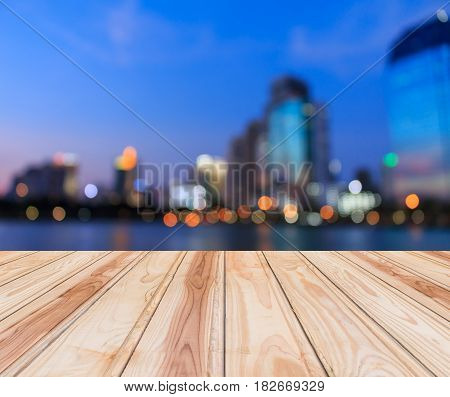 wood floor and blurred cityscape at twilight with bokeh