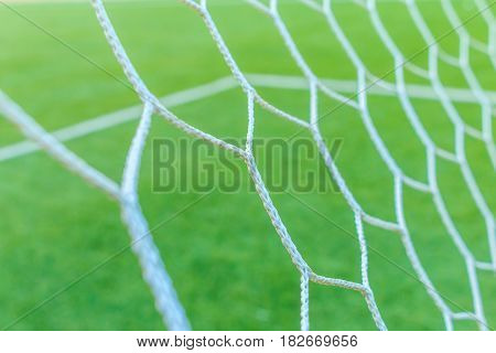 The nets of football goal with field artificial grass