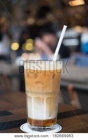 Focus of ice caramel macchiato in coffee shop area selective focus.