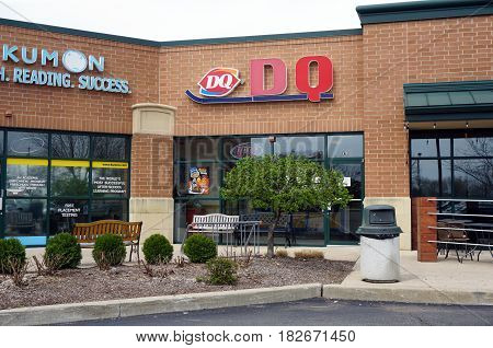 BOLINGBROOK, ILLINOIS / UNITED STATES - APRIL 14, 2017: One may eat ice cream at the Dairy Queen restaurant in the Concord Plaza in Bolingbrook.