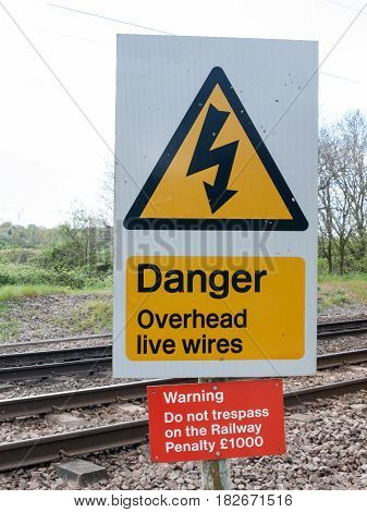 A Railway Safety Sign Saying Danger Overhead Live Wire Warning Do Not Trespass On The Railway Penalt
