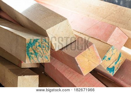 Blocks of wood with spots from paint in apartment during under renovation remodeling and construction of apartment.