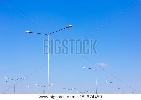 Street lights against the sky blue sky
