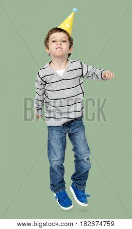 Little Boy Wearing Party Hat Studio Portrait