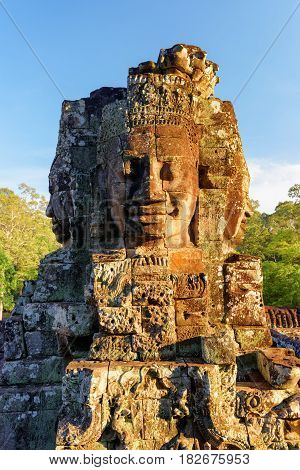 Enigmatic Face-tower Of Bayon Temple In Evening Sun. Cambodia