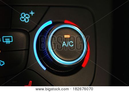 manual switches the air conditioning on the dashboard of the car