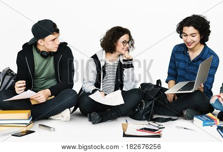Diverse Group Of Students Sitting and Study