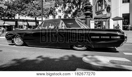 BERLIN - JUNE 05 2016: Personal luxury car Ford Thunderbird (third generation). Lowrider. Black and white. Classic Days Berlin 2016.