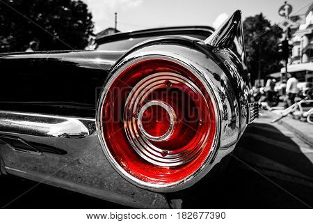 BERLIN - JUNE 05 2016: Stoplight of a personal luxury car Ford Thunderbird (third generation). Close-up. Combined toning. Black-and-white-red. Classic Days Berlin 2016.