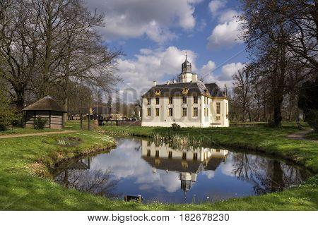 The stately castle Fraeylemaborg seen from the surrounding park near Slochteren in the Dutch province Groningen