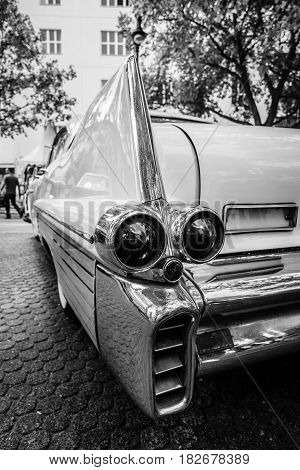 BERLIN - JUNE 05 2016: The rear brake lights of full-size luxury car Cadillac Fleetwood Series 70 Eldorado Brougham 1957. Black and white. Classic Days Berlin 2016.