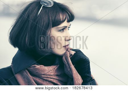 Sad beautiful fashion woman in leather coat outdoor