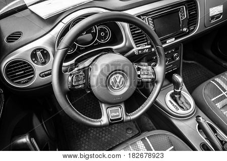 BERLIN - JUNE 05 2016: Interior of compact car Volkswagen Beetle Cabriolet 2016. Black and white. Classic Days Berlin 2016.