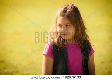 portrait latin girl in summer park