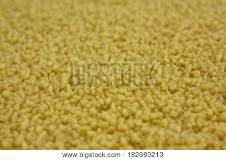 Raw organic couscous background, tasty, natural top view