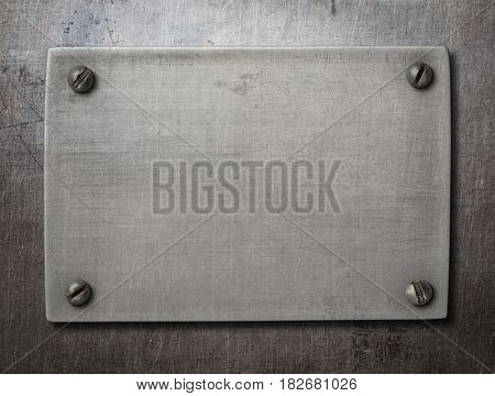 old steel plate with bolts on metal background