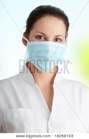 Young nurse or doctor in mask