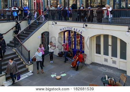 LONDON, GREAT BRITAIN - MAY 13, 2014: This performance of street musicians in the premises of the Covent Garden market.