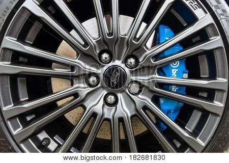 BERLIN - JUNE 05 2016: The brake system and wheel of compact car Ford Focus RS (third generation) close-up. Classic Days Berlin 2016.