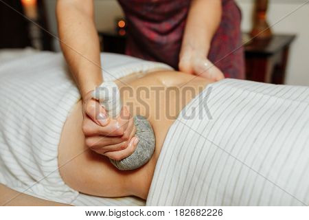Spa Massage Of The Stomach With Herbal Compresses According To The Thai Method