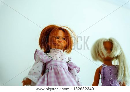 Dolls on shelves in a toy store