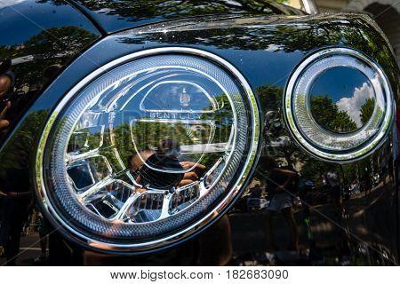 BERLIN - JUNE 05 2016: Headlamp of ultra luxury crossover SUV Bentley Bentayga 2016. Classic Days Berlin 2016.