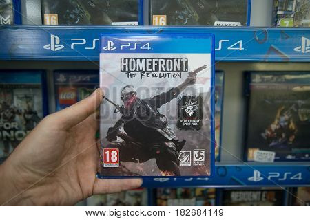 Bratislava, Slovakia, circa april 2017: Man holding Homefront The Revolution videogame on Sony Playstation 4 console in store