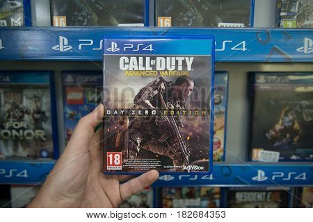 Bratislava, Slovakia, circa april 2017: Man holding Call of Duty Advanced Warfare videogame on Sony Playstation 4 console in store