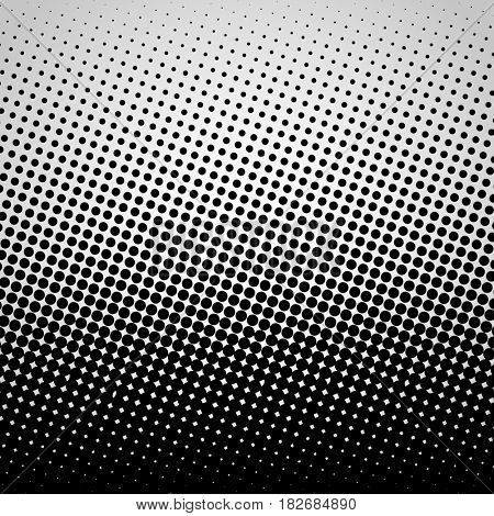 Halftone abstract black dots design element isolated on a white background.