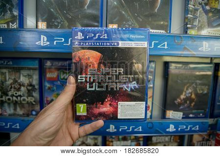 Bratislava, Slovakia, circa april 2017: Man holding Super, Stardust Ultra VR videogame on Sony Playstation 4 console in store