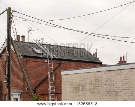 A Ladder Up The Side Of A House And Along The Roof Construction No People Or Workers