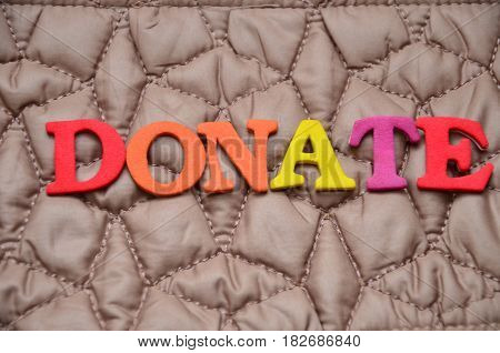 word donate on a  abstract colorful background