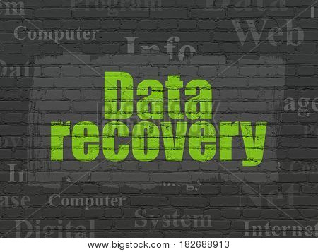 Information concept: Painted green text Data Recovery on Black Brick wall background with  Tag Cloud