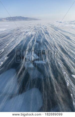Snowstorm On Ice Of Lake Baikal. Winter Landscape