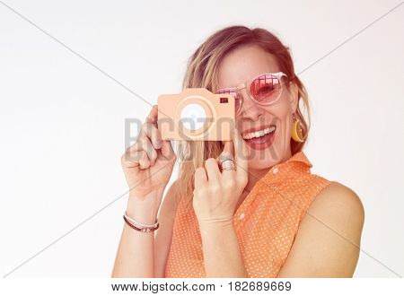 Woman gesture holding camera and taking photo