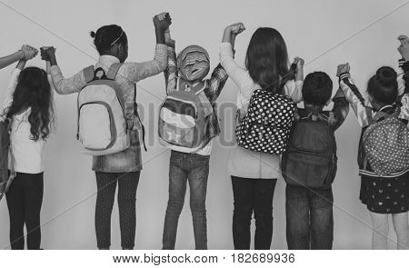 Group of School Friends Holding Hands with Rear View on White Background