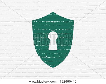 Safety concept: Painted green Shield With Keyhole icon on White Brick wall background