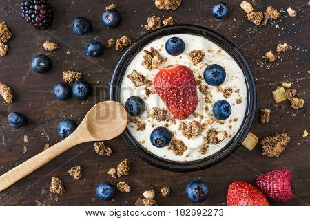Serving of Fresh White Yogurt with Raspberry Blueberries and Muesli