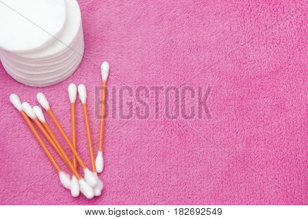 Cotton pads and swabs bulk of q tips on the pink plush cloth